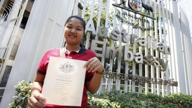 Pattharamon Janbua with a certificate of Australian citizenship for Gammy outside the Australian embassy in Bangkok earlier this month.