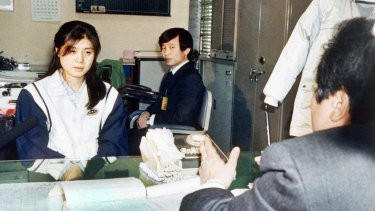 A prosecutor questions Kim Hyon-hui, left, on December 2, 1988, about the  bombing of a South Korean airliner in which all 115 people on board died.