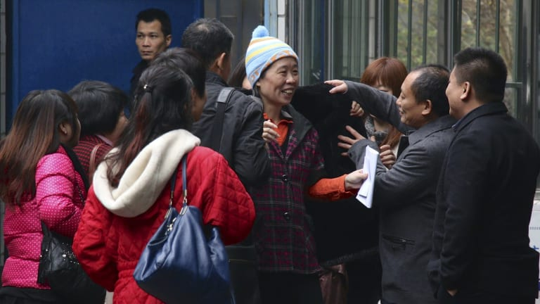 Relief: Charlotte Chou was immediately swamped by family and friends.