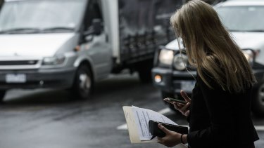 Pay attention: Pedestrians are being told to watch the road, not their phones.