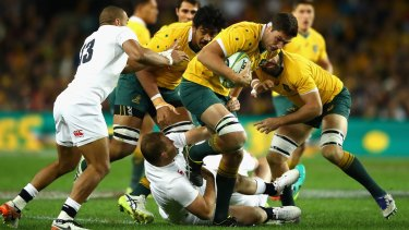 Rounded up: Wallabies forward Rob Simmons is tackled during the Test between Australia and England at Allianz Stadium.