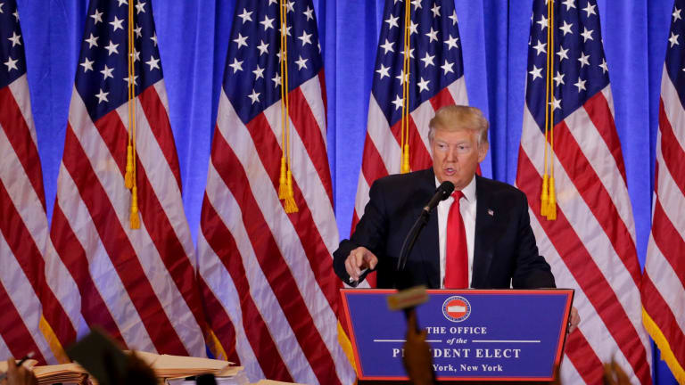 President-elect Donald Trump takes questions from members of the media during a news conference.