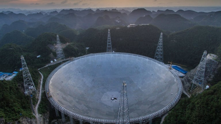 The sun sets above the Aperture Spherical Telescope in Pingtang County in southwestern China's Guizhou Province last week.