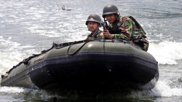 Indonesian soldiers patrol on a rubber boat in Biruen, Aceh province.
