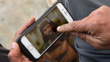 Yusuf Abbas points to a photo of Neil Prakash identifying him as the foreign fighter he saw in a Mosul market with bodyguards and an interpreter.