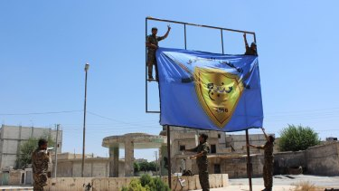 An August 8 photo released by a pro-Kurdish news agency shows   the Kurdish-led Syrian Democratic Forces raising a banner in the centre of the town of Manbij. That success may have provoked the Turkish incursion into Syria at Jarablus.