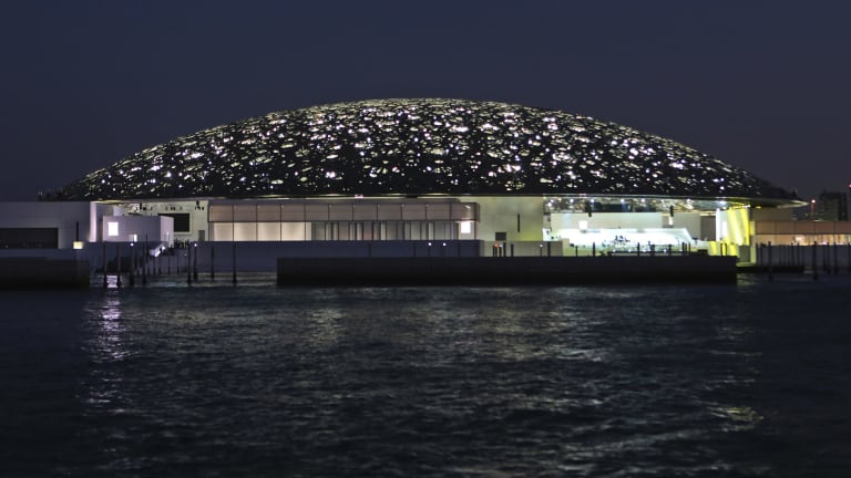 The night view of the Louvre Abu Dhabi, United Arab Emirates.