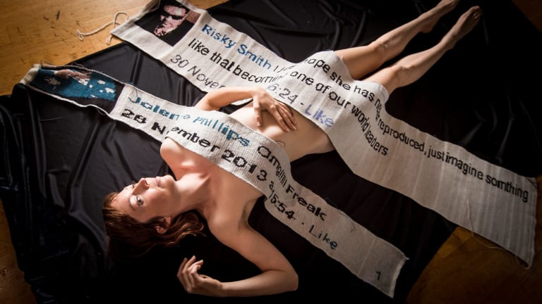 Jenkins with some of the banners she's knitted with online comments about her work.