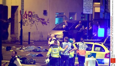 Police at the scene of the crash in Finsbury Park, north London, in which a van ploughed into a group of people.