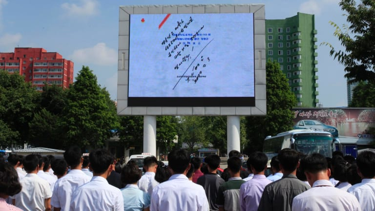 The hand that signed the paper: North Korean leader Kim Jong-un's signature is shown on the order authorising the launch.