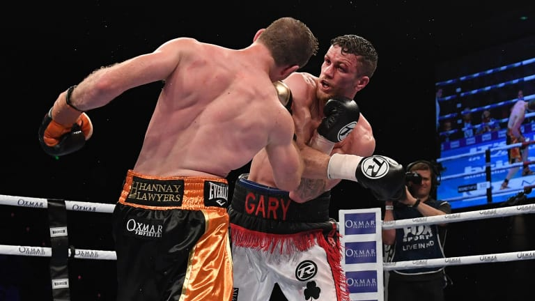 Brutal encounter: Horn and Corcoran trade shots in what became a bloody war in the middle rounds.