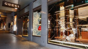 7a00cc69b95 Thieves used sedgehammers to smash their way into the Gucci handbags store  on Collins Street.