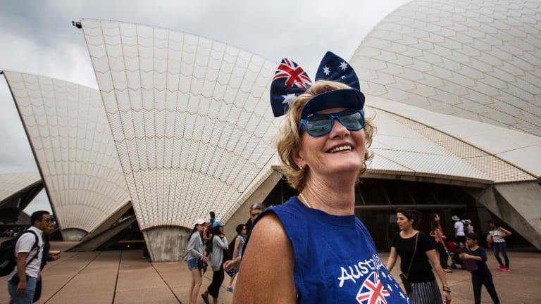 A woman celebrates Australia Day by the Sydney Opera House on January 26, 2017.