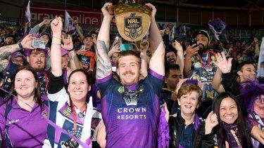 Cameron Munster celebrates Storm's premiership with fans.
