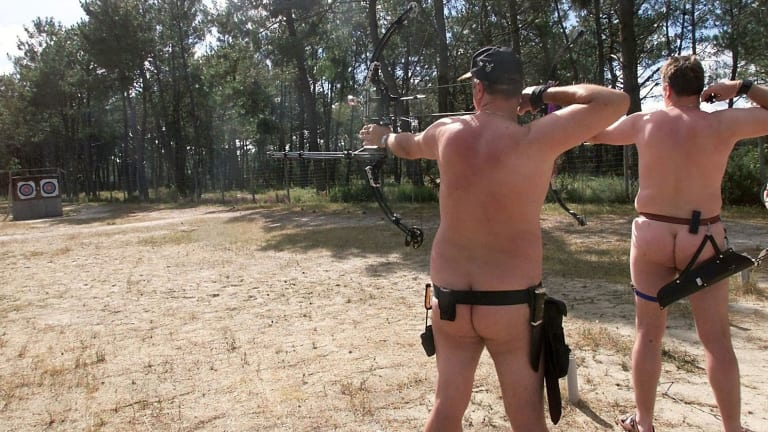 Nudists in Europe try a spot of beach archery.