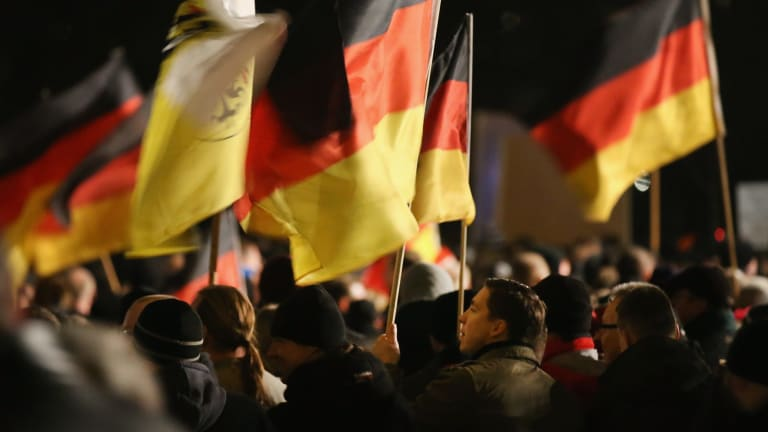 Supporters of the Pegida movement march in Dresden.