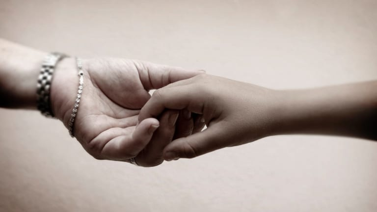 ''Touching another person is the most elementary thing,'' Kate Holden writes to her son.