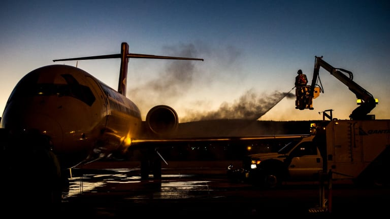 De-iceing work on the Qantas aircraft at Canberra airport in sub-zero temperatures.