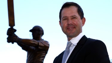 Immortal: Ricky Ponting poses with his statue at Blundstone Arena in Hobart, Tasmania.