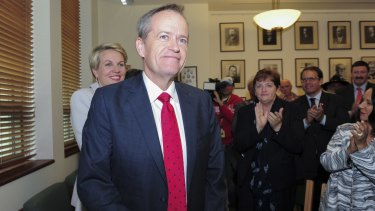 Leader Bill Shorten and deputy Tanya Plibersek are applauded as they arrive for the caucus meeting on Friday.
