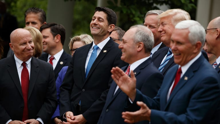US President Donald Trump with fellow Republicans after passing their healthcare bill.