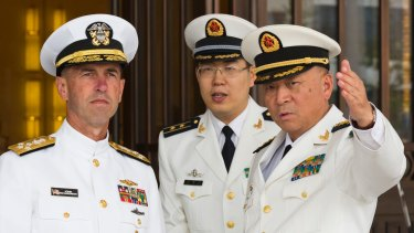 US Chief of Naval Operations Admiral John Richardson, left, listens to Commander of the Chinese Navy Admiral Wu Shengli, right, at Chinese Navy Headquarters in Beijing in 2016.