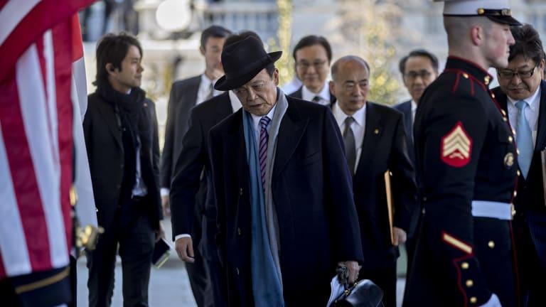 Japanese Deputy Prime Minister Taro Aso arrives at the White House.