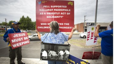 Protestors against child abuse within the Catholic Church stand out the front of the Ballarat Magistrate's Court before the Royal Commission into child sex abuse begins.