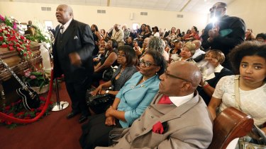 A family member stands and reacts to the eulogy by Reverend Herron Wilson for BB King.