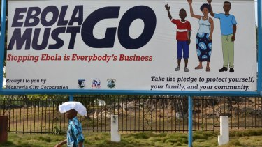 """An ebola campaign banner with the new slogan """"Ebola Must GO"""" in Monrovia, Liberia, in February this year."""