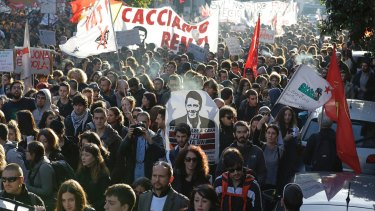 """People march behind a banner portraying Italian premier Matteo Renzi that reads """"Let's oust Renzi"""" during a demonstration against the referendum changes."""