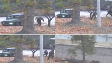 A North Korean soldier running from a jeep and then shot by North Korean soldiers in Panmunjom, North Korea as he flees for the South in November.