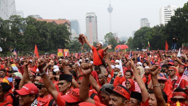 Ethnic Malays stage a rally in Kuala Lumpur to uphold Malay dominance and support Prime Minister Najib Razak's government.
