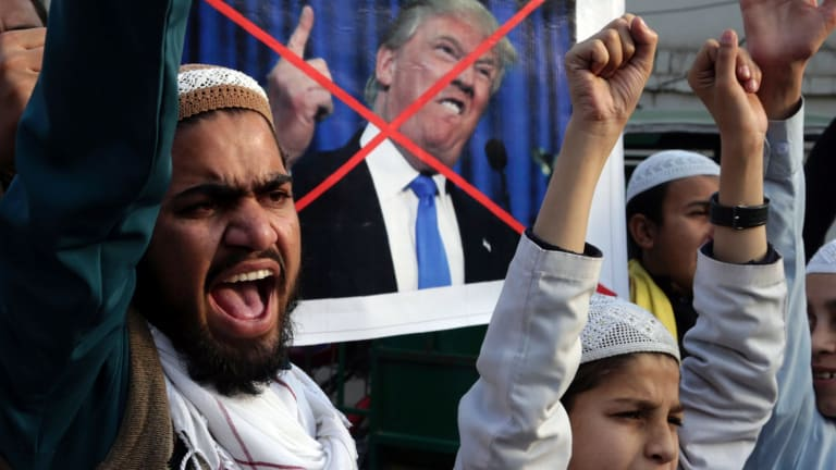 Pakistani religious students protest against US President Donald Trump in Lahore, Pakistan, on Friday.