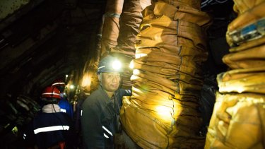 A worker in a mine in China operated by Yanzhou Coal. Yancoal, owned by Yanzhou, is buying Rio coal mines in NSW.
