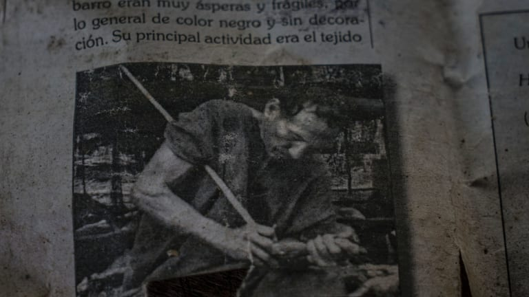 A photo of Garcia's late father in an old Peruvian history book that Amadeo keeps as one of the last photos of his family.