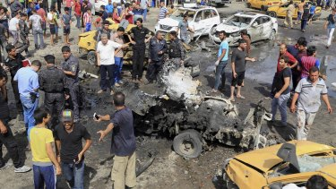 The aftermath of suicide car bombing in Sadr City on Tuesday.