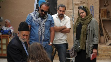 Narges Abyar, right, directs a scene in her film