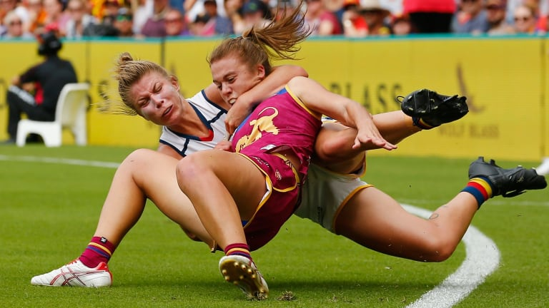 Fierce tackle: Kellie Gibson of the Adelaide Crows clashes with Jamie Stanton of the Brisbane Lions.