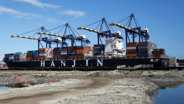 The container ship Hanjin Boston is unloaded at the Port of Los Angeles on Tuesday.
