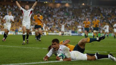 Career highlight: Jason Robinson scores for England in the World Cup final against Australia in Sydney in November 2003.