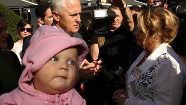 """Prime Minister Malcolm Turnbull, on the campaign trail in Penrith with one-year-old Freya Brown, said last week """"the budget is very fair""""."""