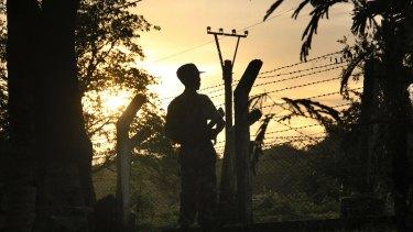 A border patrol guard at a police post in Kyee Kan Pyin, Buthidaung, Rakhine state Myanmar.