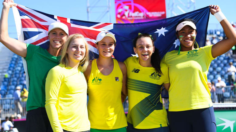 Australian Fed Cup team captain Alicia Molik, Daria Gavrilova, Ashleigh Barty, Casey Dellacqua and Destinee Aiava celebrate Australia's win over Ukraine at the Canberra Tennis Centre.