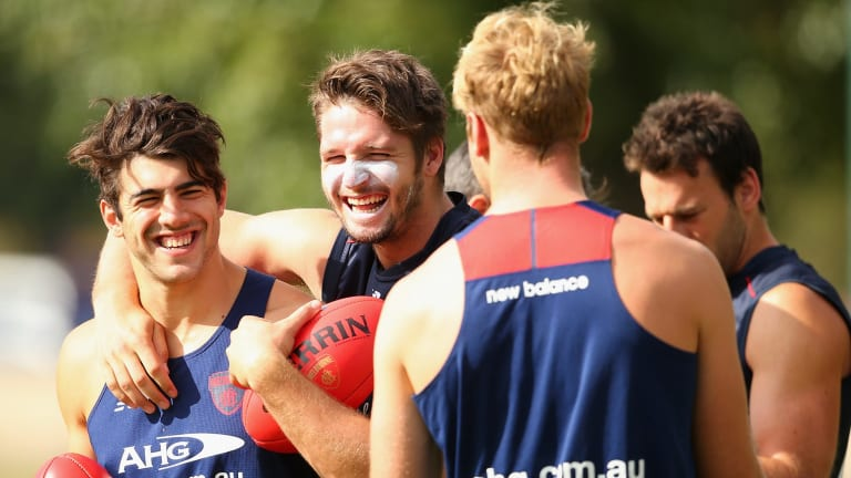 Team spirit: Demons Christian Petracca, Jesse Hogan and Jack Watts have a laugh during a training session at Gosch's Paddock.