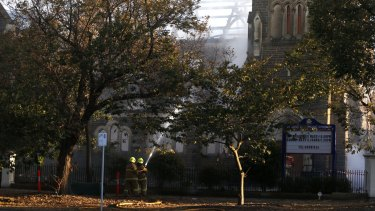 Firefighters battle the blaze at  St James Church in Brighton.