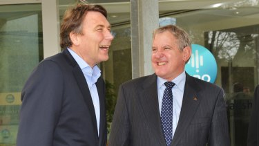 CSIRO chairman David Thodey with Federal Industry Minister Ian MacFarlane. CSIRO funding cuts have impacted on its annual climate change survey.