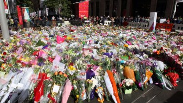 Tribute: The memorial to the victims of the Lindt cafe siege continued to grow in Martin Place on Wednesday.