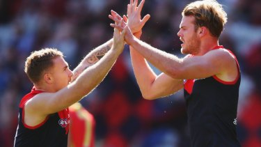 Demons Dean Kent and Jack Watts celebrate a goal during the win against Gold Coast on Sunday.