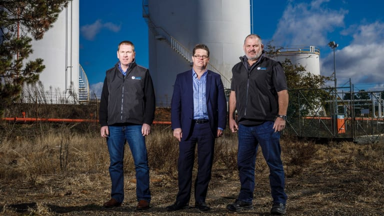 Director of Capital Recycling Solutions Adam Perry, Dean Ward from ActewAGL, and project manager Ewen McKenzie at the former Shell site marked for a waste-to-energy factory at Fyshwick.